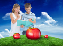 Composite image of concentrated brother and sister learning their lesson together Stock Photography