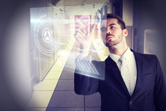Composite image of concentrated businessman measuring something with his fingers Royalty Free Stock Images