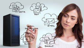 Composite image of concentrated businesswoman holding whiteboard marker Stock Photo