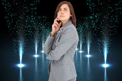 Composite image of concentrating businesswoman Stock Image