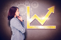Composite image of concentrating businesswoman Royalty Free Stock Photos