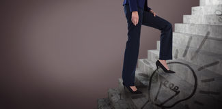 Composite image of conceptual image of businesswoman in heels climbing steps Royalty Free Stock Images