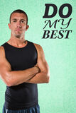 Composite image of confident athlete with arms crossed Royalty Free Stock Photo