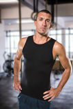 Composite image of confident athlete with hands on hip standing Royalty Free Stock Photography