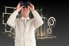 Composite image of confident businessman with binoculars Royalty Free Stock Photos