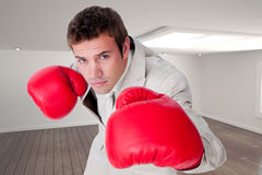 Composite image of confident businessman wearing boxing gloves Royalty Free Stock Photos