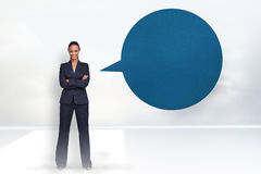 Composite image of confident businesswoman with speech bubble Royalty Free Stock Photo