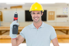 Composite image of confident carpenter holding cordless drill machine Stock Photos