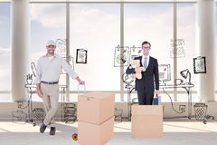 Composite image of confident delivery man with cardboard boxes Stock Images