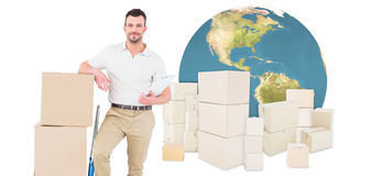 Composite image of confident delivery man with cardboard boxes Royalty Free Stock Photo