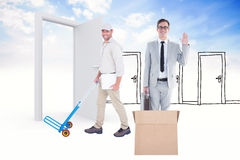 Composite image of confident delivery man pushing empty trolley Stock Photography
