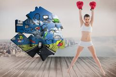 Composite image of confident fit brown haired model in sportswear jumping and wearing boxing gloves Royalty Free Stock Photos
