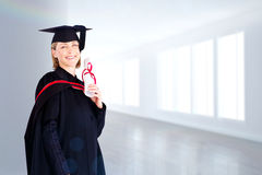 Composite image of confident graduated woman looking at the camera Royalty Free Stock Images