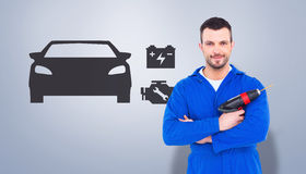 Composite image of confident handyman holding power drill Royalty Free Stock Images