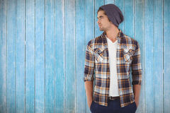 Composite image of confident hipster looking away while standing Stock Image
