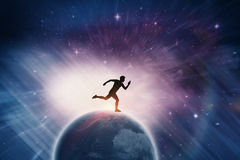 Composite image of confident male athlete running from starting blocks. Confident male athlete running from starting blocks against outer space Royalty Free Stock Images