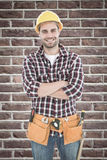 Composite image of confident male handyman wearing tool belt Royalty Free Stock Image