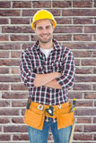 Composite image of confident male handyman wearing tool belt Royalty Free Stock Photos