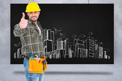 Composite image of confident manual worker gesturing thumb up Stock Image