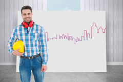 Composite image of confident manual worker with hardhat and ear muffs Royalty Free Stock Image