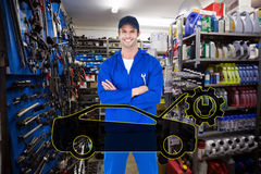 Composite image of confident mechanic holding wheel wrenches Stock Images