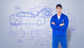 Composite image of confident mechanic holding wheel wrenches Stock Photo