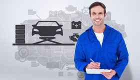 Composite image of confident of mechanic writing notes on clipboard Royalty Free Stock Photography