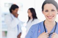 Composite image of confident nurse standing stock images