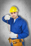 Composite image of confident repairman holding cables Royalty Free Stock Photos