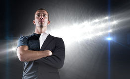 Composite image of confident rugby player with arms crossed Stock Photography