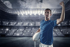 Composite image of confident rugby player flexing muscles Stock Photos