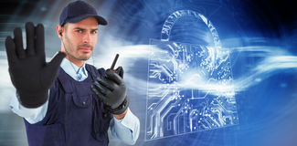 Composite image of confident security officer making stop gesture Royalty Free Stock Images
