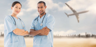 Composite image of confident surgeons with arms crossed in hospital Stock Photo