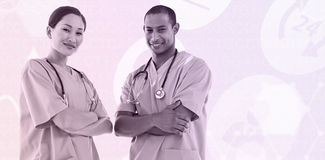 Composite image of confident surgeons with arms crossed in hospital Royalty Free Stock Photo