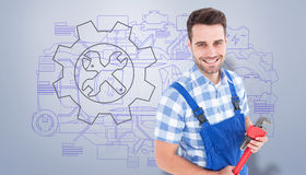 Composite image of confident young male repairman holding monkey wrench Royalty Free Stock Photos