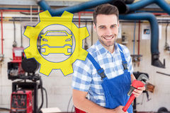 Composite image of confident young male repairman holding monkey wrench Royalty Free Stock Images