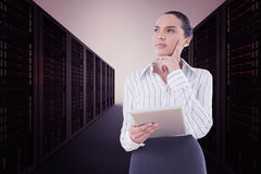 Composite image of confused businesswoman using a tablet pc Stock Photos