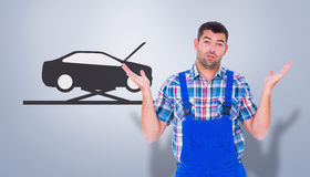 Composite image of confused handyman giving i dont know gesture Royalty Free Stock Image