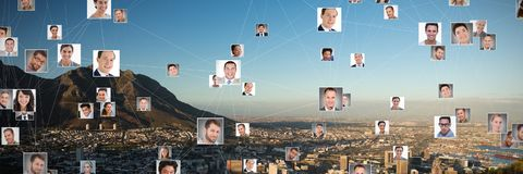 Composite image of composite image of connected business people. Composite image of connected business people against city on a sunny day royalty free stock photo