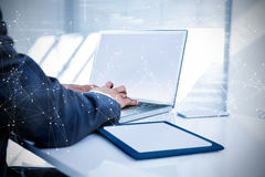 Composite image of constellation of stars. Constellation of stars against businessman using his computer royalty free stock photography