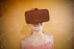 Composite image of constellation of stars. Constellation of stars against girl using the virtual reality device royalty free stock photo