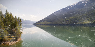 Composite image of constellation between stars. Constellation between stars against idyllic view of lake Stock Image