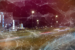 Composite image of constellation between stars. Constellation between stars against illuminated city street royalty free stock images