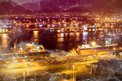 Composite image of constellation between stars. Constellation between stars against illuminated harbor against cityscape stock image