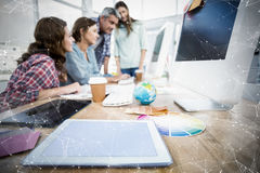 Composite image of constellation between stars. Constellation between stars against tablet in the foreground with business people in the background royalty free stock photo
