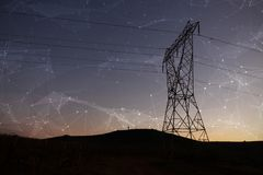 Composite image of constellation between stars. Constellation between stars against the evening electricity pylon silhouette royalty free stock photo