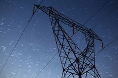 Composite image of constellation of stars. Constellation of stars against the evening electricity pylon silhouette stock images