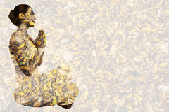 Composite image of content brunette in white sitting in lotus pose Stock Images