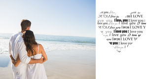 Composite image of content couple looking at the sea Royalty Free Stock Photo