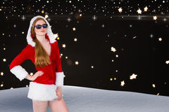 Composite image of cool santa girl wearing sunglasses Stock Image